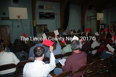 Great Salt Bay School budget voters approve a warrant article during Tuesday's meeting. (Joe Gelarden photo)