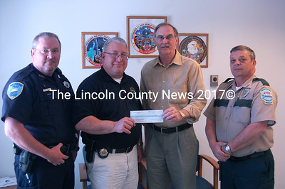 Members of the Waldoboro Police Department receive two checks from the Waldoboro Free Masons on May 17 at the Waldoboro Police Station. The masons gave $50 to the D.A.R.E. program and $125 to sponsor a Waldboro student going to Camp POSTCARD this summer. Pictured, from left: Waldoboro Police Officer Tom Hoepner, Police Chief Bill Labombarde, Mason Carl Wolff, and Lodge Treasurer William Bragg. (Samuel J. Baldwin photo)