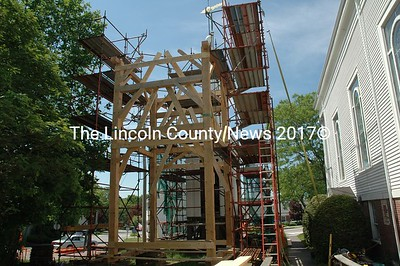 Here is what the big crane at the Damariscotta Baptist Church was doing on May 25. The crane stood up these mighty timbers so craftsmen could put them together to form the frame of the new clock tower. (Joe Gelarden photo)