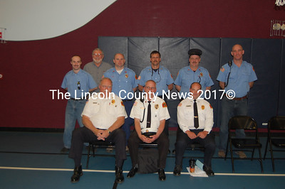 Members of the Edgecomb Fire Dept., moments after voters approved a new fire station. Seated, from left to right: Assistant Fire Chief Larry Omland, Fire Chief Roy Potter and Steve Ward. Standing: T.J. Wooster, Jack French, John Potter, Jim Fisk, Pete Turner and Greg Rollins (J.W. Oliver photo)