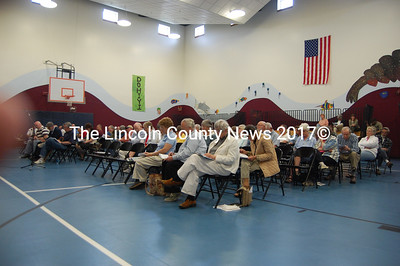 Edgecomb voters study the town report at town meeting May 22. (Photo by J.W. Oliver)
