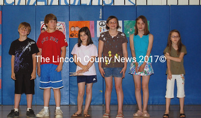 The JVS state champion Odyssey of the Mind team soaks in the applause at an assembly on May 25 to honor them before they leave for the World Finals in Michigan. Team members are, from left: Lucas Grotten, 3rd grade, John Henry, 5th grade, Courtney Peabody, 5th grade, Emily Huber, 5th grade, Roberta Anderson, 5th grade, and Emma Solorzano, 4th grade. (Alex Toy photo)