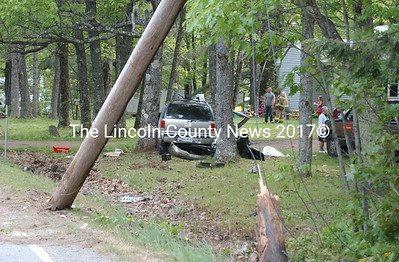 A GMC sport utility vehicle crashed into a telephone pole, splitting the pole into two pieces, before carreening into a stand of trees on Rt. 218 near Cookson Lane in Whitefield May 20. (Paula Roberts photo)
