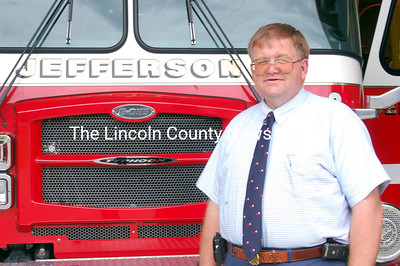 New Jefferson Fire Chief Walter Morris stands with one of the department's trucks at the fire station on Bunker Hill Road in Jefferson on May 3. (Samuel J. Baldwin photo)
