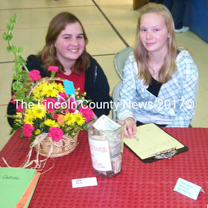 Eighth grade volunteers (left to right): Kasidee Brackett and Marissa White. (J.W. Oliver)