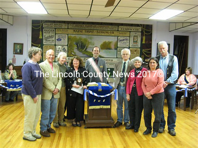 Members of Whitefield's Bicentennial Committee receive a Spirit of America Award, presented by Rick Grotton, Maine State Grange executive committee member. From left: Cathey Sell, Tim Chase, Libby Harmon, Sue McKeen; (right of Grotton) Bill McKeen, Marie Sacks, Jeanne and Mike Shaw.