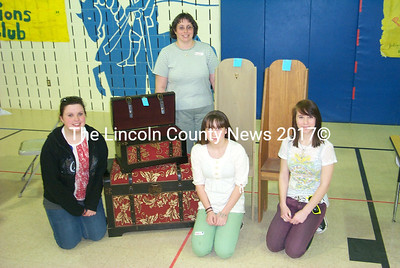 Helping to raise money are (kneeling, from left to right): Cassie Reed, Rebekah Bois and Lily Briggs. Standing: Eighth grade teacher Michelle Duncan-Shaw. (J.W. Oliver photo)