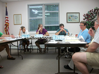 Newcastle selectmen discuss the asbestos discovery on Lynch Road Monday at their biweekly meeting.