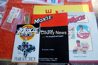 Moxie books, stickers and collectables are on display and for sale at the Waldoboro Moxie Fest on July 8 at Moody's Diner. (Alex Toy photo)