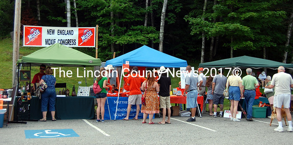Patrons of Moxie Fest on July 8 at Moody's Diner on Rt. 1 in Waldoboro enjoy free samples of the quintessential Maine soft drink, displays of Moxie memorabilia and a general good time. (Alex Toy photo)