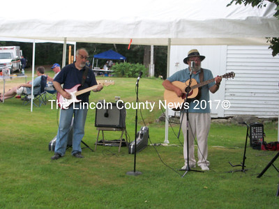 Kenny Cox and Dick Dow serve up some folk music at the Dresden Summerfest Saturday.