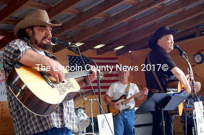 Country Jim Palmer, left, and Bill Giasson, foreground right, take the stage at the Coming Together in Country Music show at Broken Acres Family Retreat in Jefferson. (Samuel J. Baldwin photo)