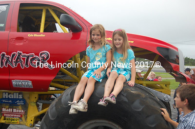 Two young fans sit happily on Dominator's enormous tires. (J.W. Oliver photo)
