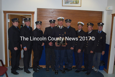 Members of the Damariscotta Fire Department proudly display the SHAPE plaque from the Department of Labor. From left to right: Allan Roberts, Captain John Roberts, Josh Martin, Assistant Chief Robert Genthner, Chief Neil Genthner, Nathan Teel, First Assistant Chief John Pinkham, Second Assistant Chief Josh Pinkham and Captain Steve O'Bryan (J.W. Oliver photo)