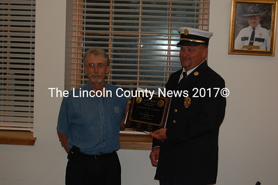 William Peabody, Director of the Bureau of Labor Standards for the Department of Labor, presents Damariscotta Fire Chief Neil Genthner with the SHAPE award. (J.W. Oliver photo)