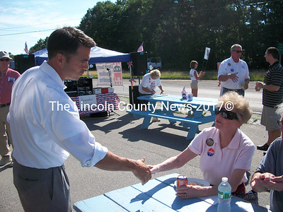 First District Congressional Candidate Dean Scontras greets Judi Lawrence, of Nobleboro, Tuesday, July 27 at the Lincoln County Republican Headquarters in Damariscotta. (A.Brodsky photo)