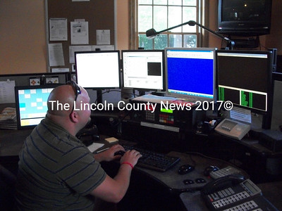 Josiah Winchenbach, of Jefferson, monitors his PSAP station in the event of an emergency at the Lincoln County Communications 911 Center. (A. Brodsky photo)
