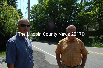 Representative Jon McKane, left, and MDOT Commissioner David Cole discuss two sinkholes on the Bristol Road in Damariscotta. (Alex Toy photo)