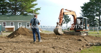 Steve Flagg and Frank Waltz, of DR Flagg and Son work on a septic system at Damariscotta Lake Watershed office at Damariscotta Lake Farms.  (Paula Roberts photo)