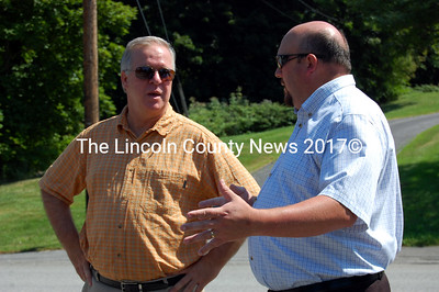 MDOT Commissioner David Cole, left, and Waldoboro Town Manager William Post discuss road construction projects. (Alex Toy photo)
