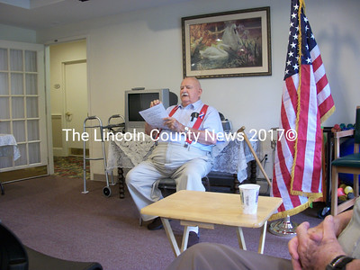 Joe Gray, a veteran of the European Theater in World War II, tells his audience about his experiences during the Battle of the Bulge and the Malmedy Massacre that occured only 10 miles from where he was positioned. (A. Brodsky photo)