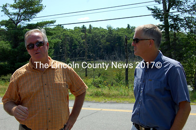 MDOT Commissioner David Cole, left, and Rep. Jon McKane discuss future projects on state roads in Lincoln County. (Alex Toy photo)