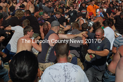 Concertgoers get rowdy in the mosh pit. (J.W. Oliver photo)