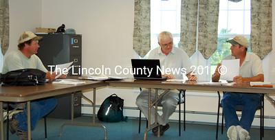 """The Jefferson Board of Selectmen discuss the mil rate for this year, which they set at 11.64 at their meeting on Aug. 2. The Board are, from left: Chairman Robert """"Jigger"""" Clark, Jim Hilton and Greg Johnston. (Samuel J. Baldwin photo)"""