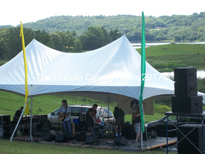 The Jason Spooner Trio sets up with Great Salt Bay in the background, Saturday, July 31. (A. Brodsky photo)