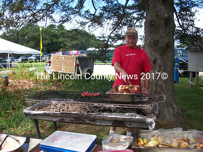 Damariscotta River Grill owner Rick Hirsch grilled up both traditional American summer and Caribbean treats at the Great Salt Bay Music Festival. (A. Brodsky photo)