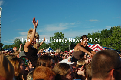 Two fans sit on friends' shoulders during Sevendust's performance. (J.W. Oliver photo)