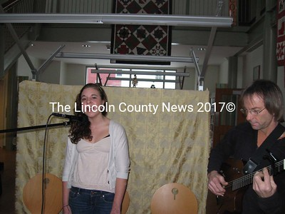 Holly Martin sings, with David Martin on guitar during Peaceful Beginnings at Skidompha Library. (Nancy Wilson photo)
