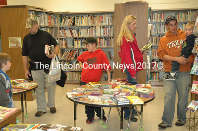Parents and kids browse books at the book fair during Literacy Night at the Miller School. (Samuel J. Baldwin photo)