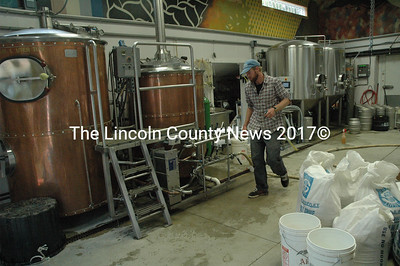 Oxbow owner and Head Brewer Tim Adams at work at the new brewery on Rt. 215 in Newcastle. (Samuel J. Baldwin photo)