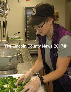 Amy Winston, director of the Real Food Institute of Midcoast Maine, helps process locally grown broccoli at MMS Oct. 13. (Samuel J. Baldwin photo)