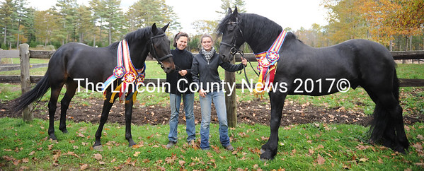 Jennifer Grady with Friesian cross Sorcsha (left) and Mandy Potter with pure bred Frieshian Rhoherrin. Both horses won National and World championshipships at the Friesian World and Grand Champion Horse Show in Lexington, Va. in early October. (P. Roberts photo)