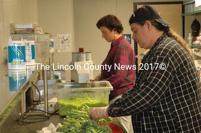 RSU/MSAD 40 Food Service Director Stormie Hendrickson, foreground, and Americorps Vista volunteer Genna Cherichello chop locally grown broccoli at MMS. (Samuel J. Baldwin photo)