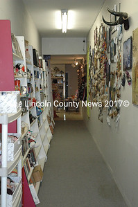 Although Hoffman Collectibles in Waldoboro has a back door that leads directly into the shop, customers coming in the Rt. 1 entrance are faced with a long hallway lined with consignment wares. (Samuel J. Baldwin photo)