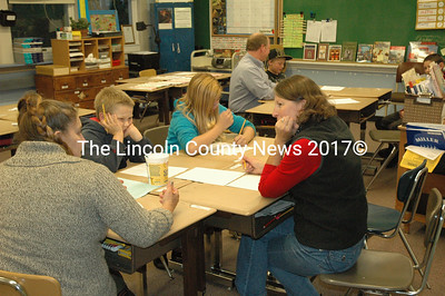 Increasing parent involvement was a big focus at Miller School Literacy Night, including teaching parents games they can play with their children. (Samuel J. Baldwin photo)