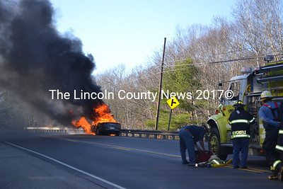 Newcastle firefighters suit up to battle a car fire on Route 1 Nov 18. (Alec Brodsky photo)