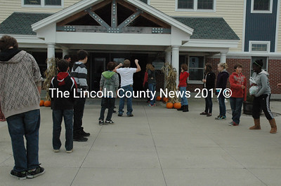 MMS students lined the halls and passed bags of food out to waiting vehicles to be delivered to local food pantries on Nov. 16. (Samuel J. Baldwin photo)