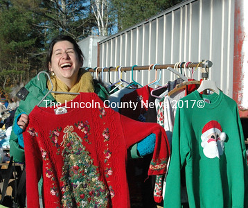 Juliana McLain Lind finds a perfect holiday sweater at the Miles Rummage Sale. (E. Busby photo)