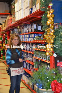 The shelves are stocked with Christmas decorating items, and all the makings for holiday crafts are available as well. Just ask customer service professional Brenda Jones. (Kim Fletcher photo)