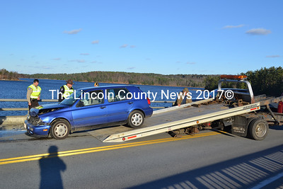 A tow truck removes one of the two cars involved an accident on the Wiscasset Bridge Nov 18. (Alec Brodsky photo)