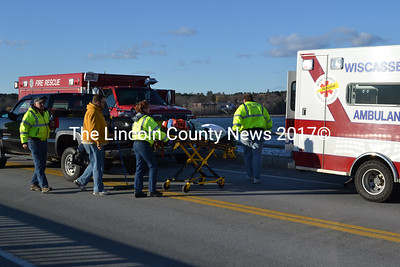 Members of Wiscasset EMS remove a victim from the scene of the accident. (Alec Brodsky photo)