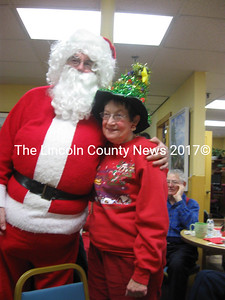 Betsy Spencer was winner of Sparkliest Hat, posing here with Santa. (Nancy Wilson photo)