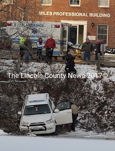 Rhonda Benner, Damariscotta, was not injured when she went through a guard rail while parking her 2011 Toyota Forerunner at Miles Memorial Hospital Tuesday morning. Damariscotta Police estimate damage at a couple of thousand dollars. The vehicle stopped short of the pond. (Paula Roberts photo)