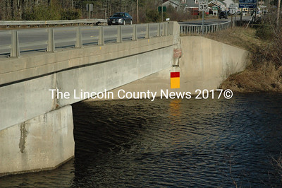 Due to concerns about scouring on the bottom of the river, DOT has placed a marker on the Rt. 1 bridge over the Medomak River in Waldoboro. If the water level reaches the top portion of the two-toned marker, it will trigger a DOT evaluation, which could lead to a closure of the bridge. (Samuel J. Baldwin photo)