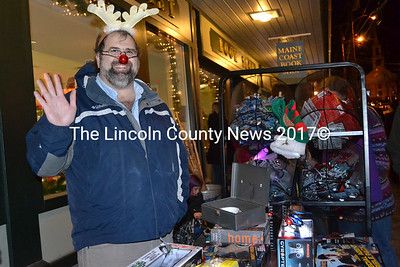 Radio Shack General Manager (for Damariscotta and Boothbay) Tom Dewey took part in Wrap It Up Street Festival to help last minute Christmas shoppers. (Kim Fletcher photo)