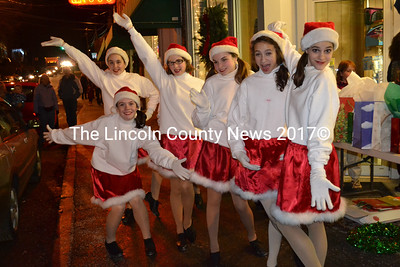 The Renys Rockets performed for Christmas crowds during the Wrap It Up Street Festival.
